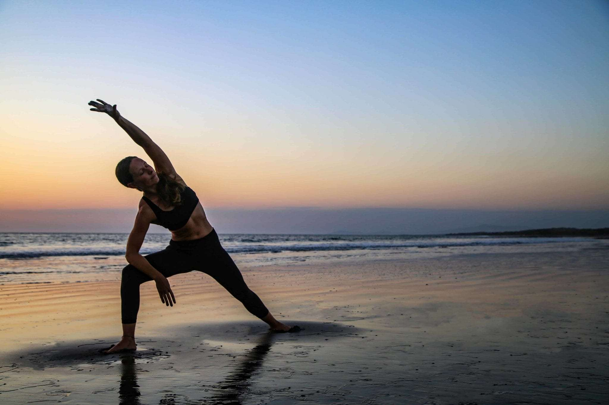 6 Stretches You Can Do Right Now to Improve Your Surf